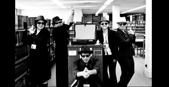 Briggs Librarians welcome new students dressed as secret agents of change.