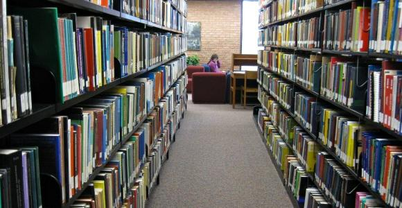 Book stacks filled with different topics.