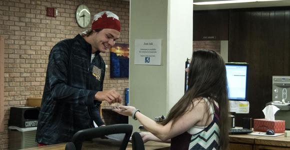 Student pays circulation worker for printing.