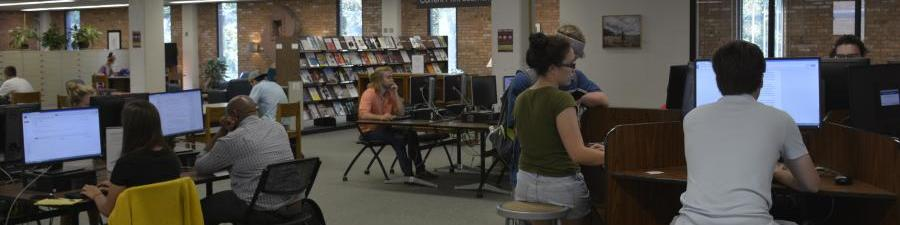 Students working on computers on the main floor of the library.