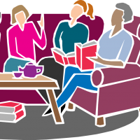 Individuals sitting and discussing a book