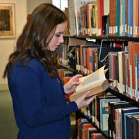 Girl reading in stacks