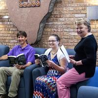Librarians reading books in Briggs Library.