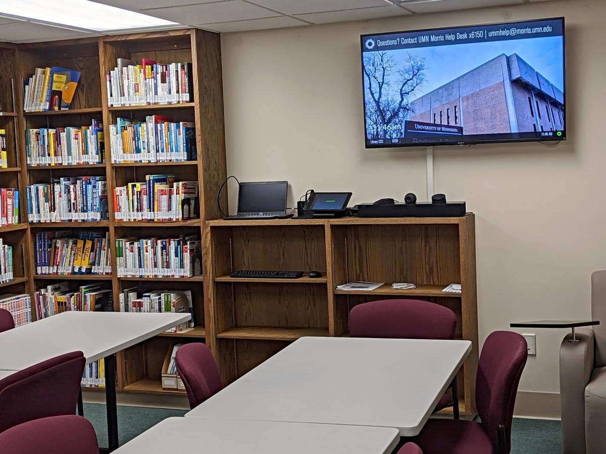 Large Flat Screen TV and tables.