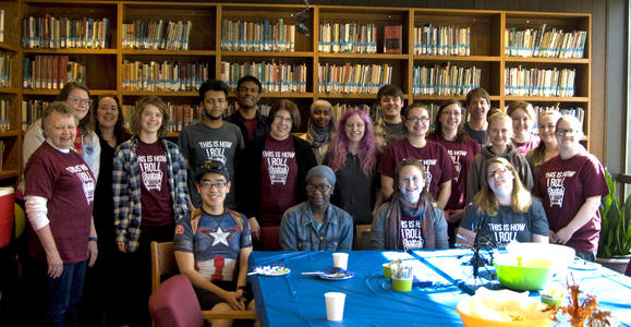 Student employees gather with librarians in the McGinnis Room.