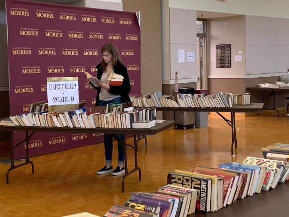 Woman shopping at book sale