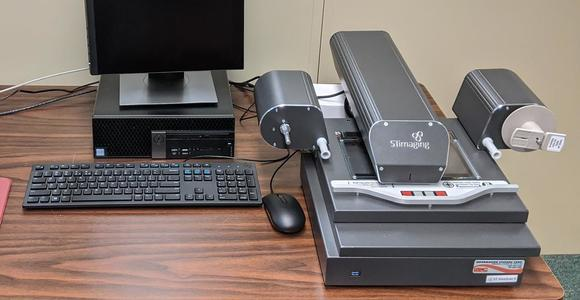 image of microfilm reader and computer.