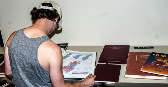 Student using an atlas.