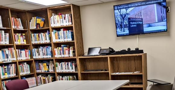 Career & Collaboration Center with screen and table