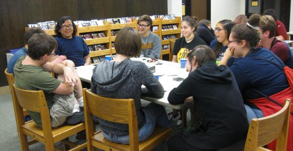 Students playing Cards Against Humanity at Game Night