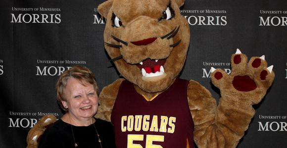 Briggs Library director with Morris mascot, Pounce.