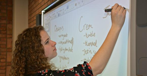 Student working with interactive whiteboard