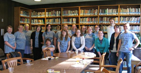 Group of student employees and librarians in the McGinnis Room.