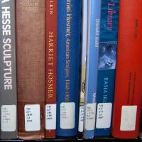 Call numbers located along the spine of books.