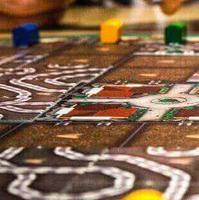 Hand reaching out to game board piece.