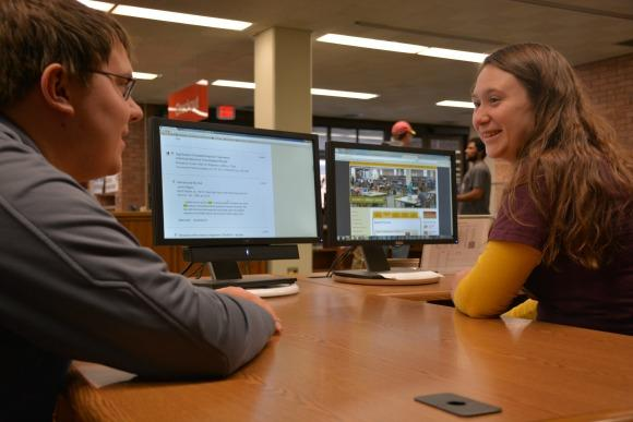 Student getting research assistance from a Briggs librarian.