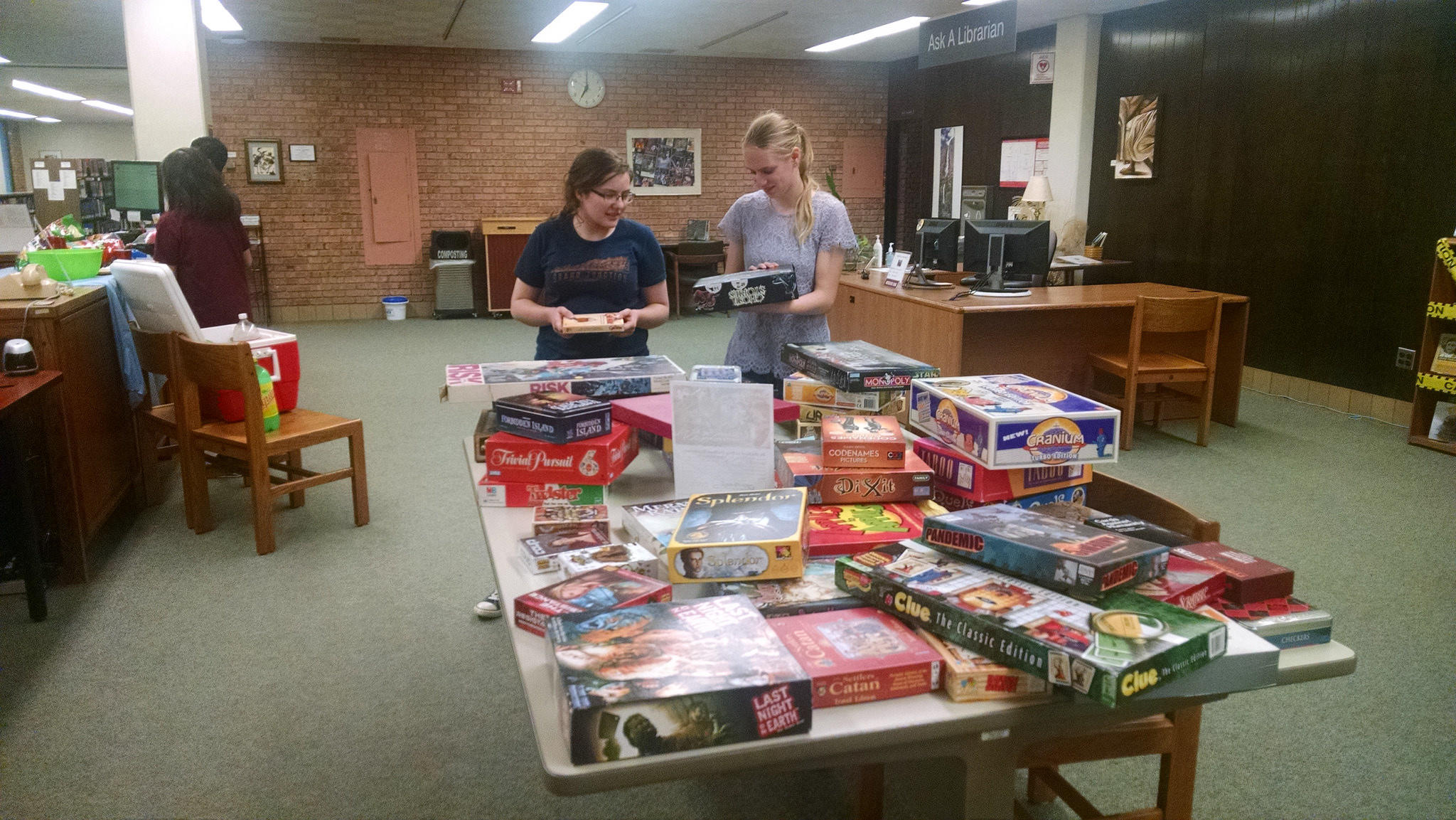 Students picking out games at Game Night