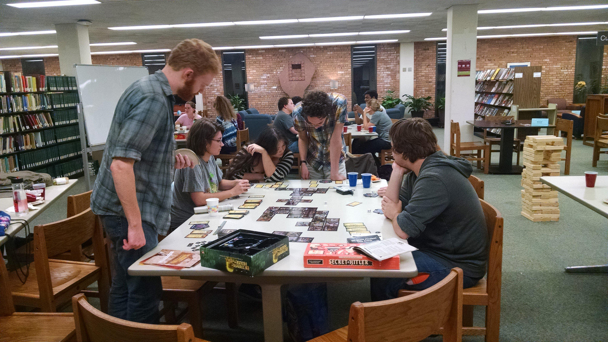 Students browsing a table full of games.
