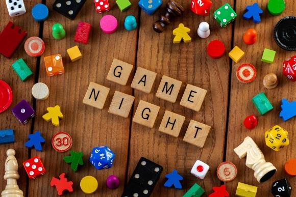 """Text """"Game Night"""" surrounded by dice and meeples."""