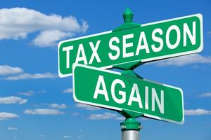 Tax Season Again street signs